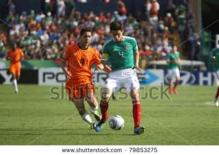 stock photo : MONTERREY, MEXICO   JUNE 24: Anass Achahbar (NED) chases